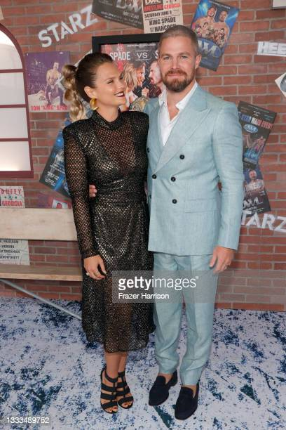 """Cassandra Jean and Stephen Amell are seen as STARZ celebrates the premiere of its new series """"Heels"""" on August 10, 2021 in Los Angeles, California."""