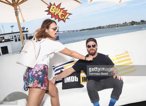 Cassandra Jean and Stephen Amell attend the #IMDboat At San Diego Comic-Con 2018: Day Three at The IMDb Yacht on July 21, 2018 in San Diego,...