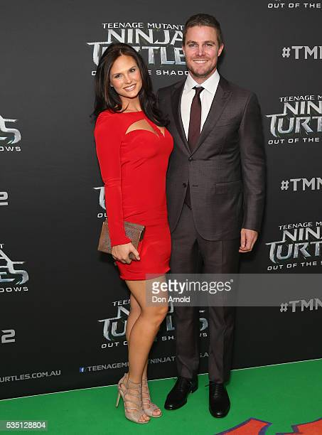 Cassandra Jean and Stephen Amell attends the Australian Premiere of Teenage Mutant Ninja Turtles 2 at Event Cinemas George Street on May 29 2016 in...