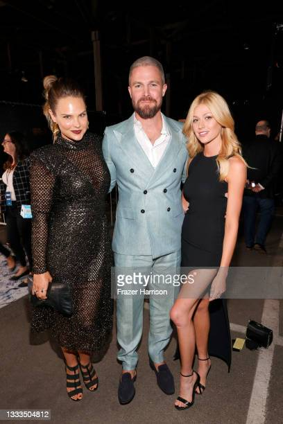 """Cassandra Jean, Stephen Amell, and Katherine McNamara are seen as STARZ celebrates the premiere of its new series """"Heels"""" on August 10, 2021 in Los..."""