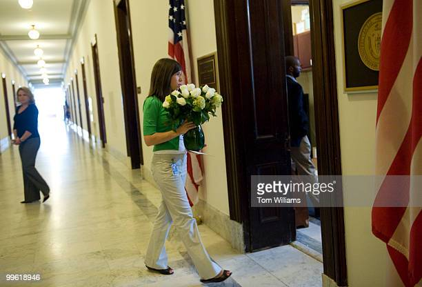 Cassandra Koehler from the office of Sen. Herb Kohl, D-Wisc., delivers flowers to the Russell office of Sen. Ted Kennedy, D-Mass., who passed away...