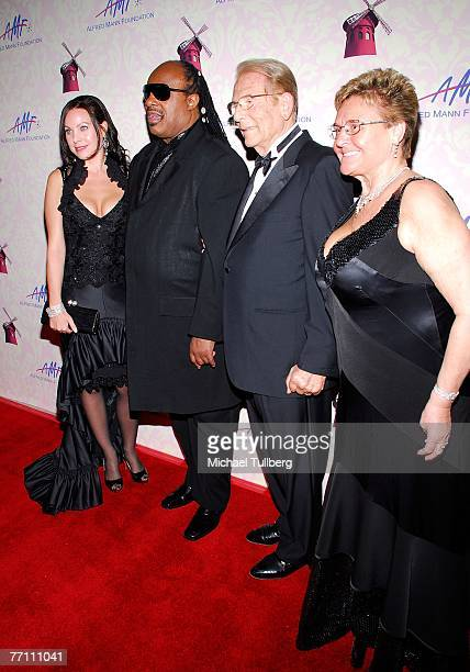 Cassandra Mann musician Stevie Wonder philantropist Alfred Mann and wife Claude Mann pose on the red carpet at the Fourth Annual Alfred Mann...