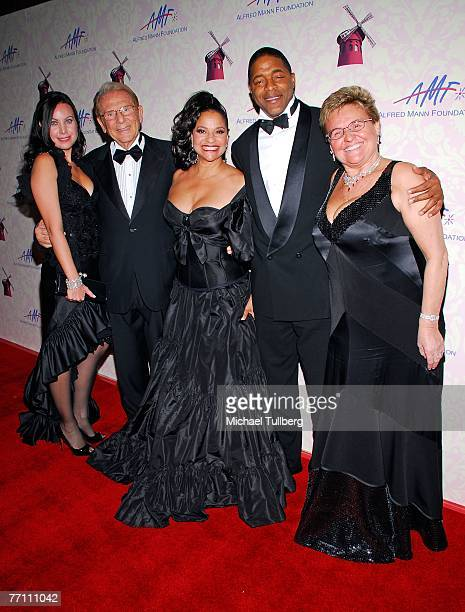 Cassandra Mann philantropist Alfred Mann actress/choreographer Debbie Allen and husband Norm Nixon and Claude Mann pose on the red carpet at the...