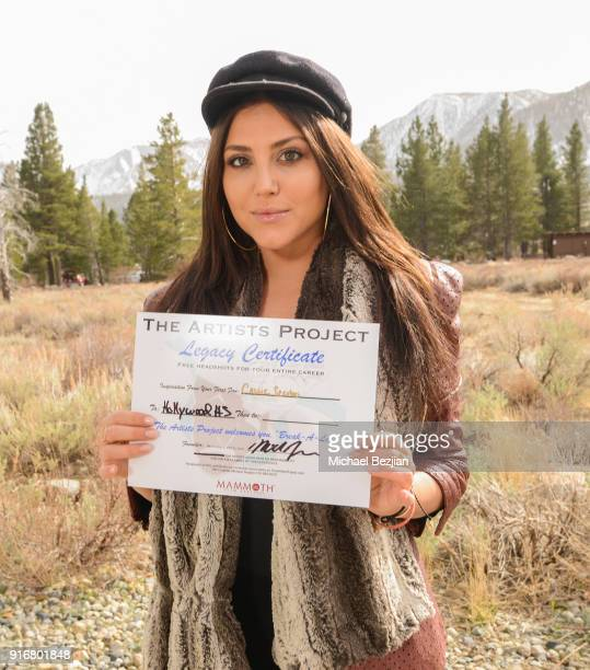 Cassandra Scerbo signs certificate for The Artists Project at The Inaugural Mammoth Film Festival on February 10 2018 in Mammoth Lakes California