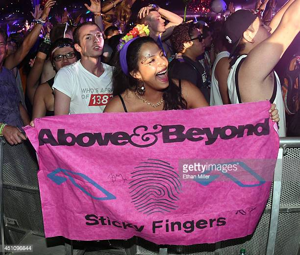 Cassandra Suarez of Illinois holds a banner as Above Beyond performs during the 18th annual Electric Daisy Carnival at Las Vegas Motor Speedway on...