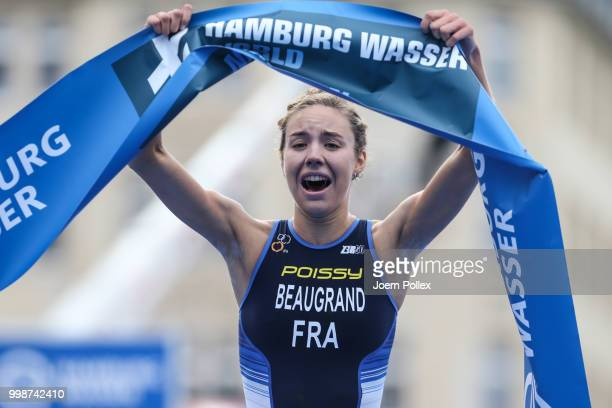 Cassandre Beaugrand of France celebrates after finishing first during the ITU World Triathlon Elite women sprint race on July 14 2018 in Hamburg...