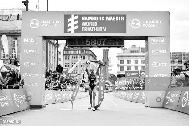 Cassandre Beaugrand of France celebrates of finishing first during the ITU World Triathlon Elite women sprint race on July 14 2018 in Hamburg Germany