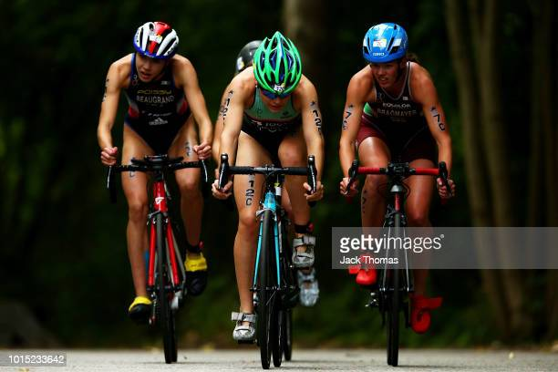 Cassandre Beaugrand of France Helena Carvalho of Portugal and Zsanett Bragmayer of Hungary compete in Leg C during the Mixed Relay Triathlon on Day...