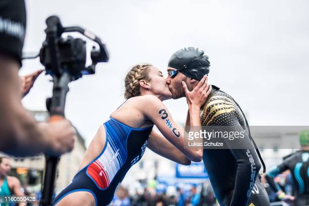 Cassandre Beaugrand of France kisses Sylvain Fridelance of Swizerland during the ITU Triathlon Mixed Relay World Championships during the Hamburg...