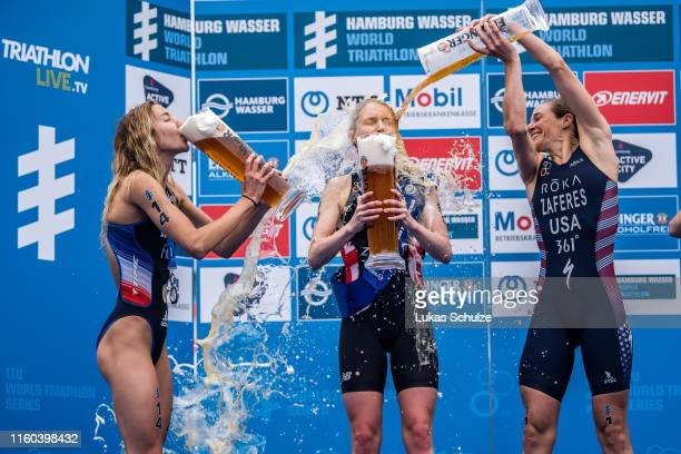 Cassandre Beaugrand of France Non Stanford of Great Britain and Katie Zaferes of USA play with beer on the podium after the ITU World Triathlon Elite...
