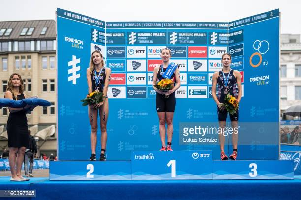 Cassandre Beaugrand of France Non Stanford of Great Britain and Summer Rappaport of USA pose on the podium aftert the ITU World Triathlon Elite women...