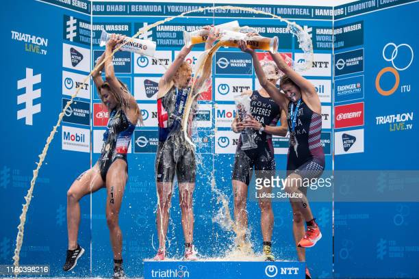 Cassandre Beaugrand of France Non Stanford of Great Britain Katie Zaferes of USA and and Summer Rappaport of USA play with beer on the podium after...