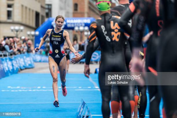 Cassandre Beaugrand of France shake hands with her team mate at the ITU Triathlon Mixed Relay World Championships during the Hamburg Wasser World...