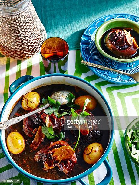 Casserole of boiled eggs and meat with glass of Chinese black vinegar