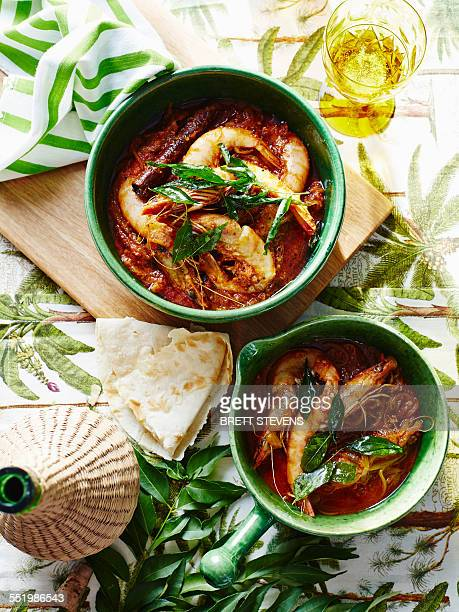 Casserole of prawns and garnish with glass of Indian coconut vinegar