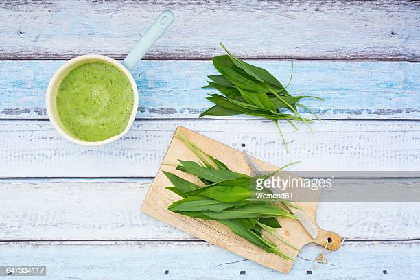Casserolle of bears garlic soup and fresh ramson leaves