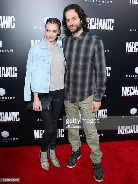 Cassi Colvin and Chris D'Elia attend the premiere of Summit Entertainment's 'Mechanic Resurrection' on August 22 2016 in Hollywood California