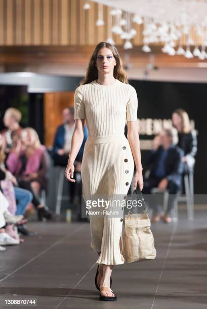 Cassi Van Den Dungen showcases designs by Anna Quan and Marni during the Gala Runway at Melbourne Fashion Festival at National Gallery of Victoria on...