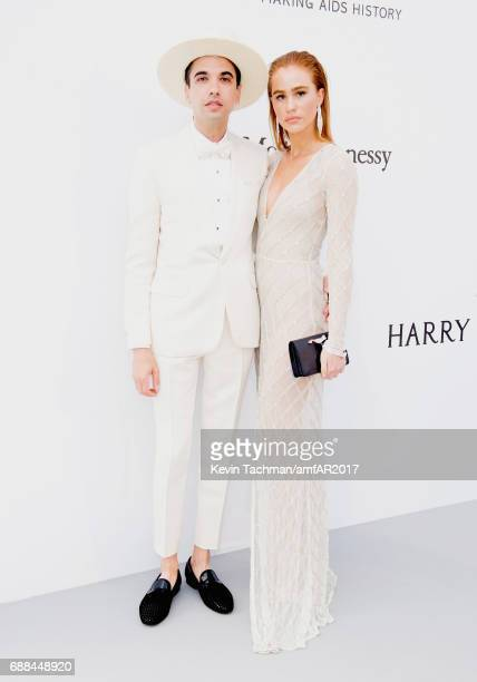 DJ Cassidy a nd guest arrive at the amfAR Gala Cannes 2017 at Hotel du CapEdenRoc on May 25 2017 in Cap d'Antibes France