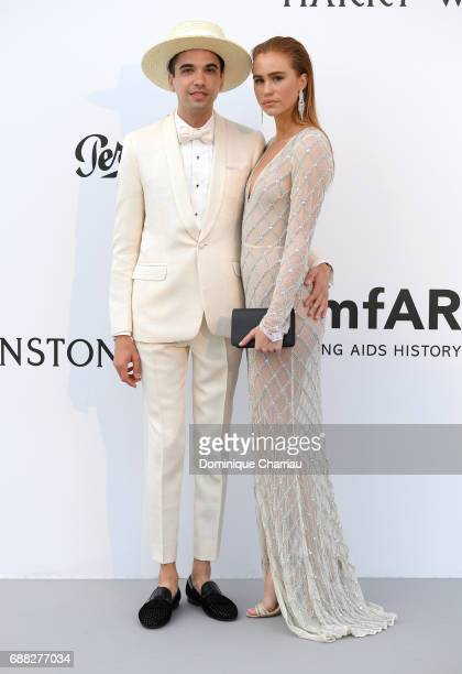 DJ Cassidy and guest arrive at the amfAR Gala Cannes 2017 at Hotel du CapEdenRoc on May 25 2017 in Cap d'Antibes France