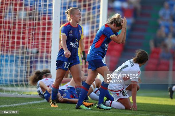 Cassidy Davis and Jenna Kingsley of the Jets look dejected after the game during the round 11 WLeague match between the Newcastle Jets and Adelaide...