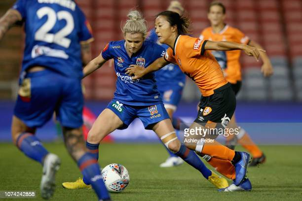 Cassidy Davis of Newcastle Jets contests the ball against Yuki Nagasato of Brisbane Roar during the round five WLeague match between the Newcastle...