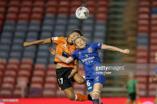 Cassidy Davis of Newcastle Jets contests the header against Yuki Nagasato of Brisbane Roar during the round five WLeague match between the Newcastle...