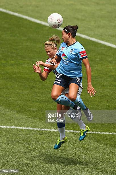Cassidy Davis of the Jets and Kyah Simon of Sydney FC compete for the ball during the round 13 WLeague match between Sydney FC and the Newcastle Jets...