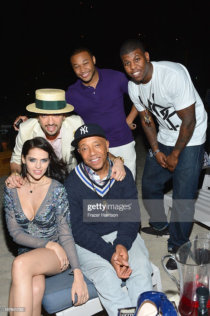 DJ Cassidy, (Front) Hana Nitsche and Russell Simmons attends the amfAR Inspiration Miami Beach Party on December 6, 2012 in Miami Beach, United States.