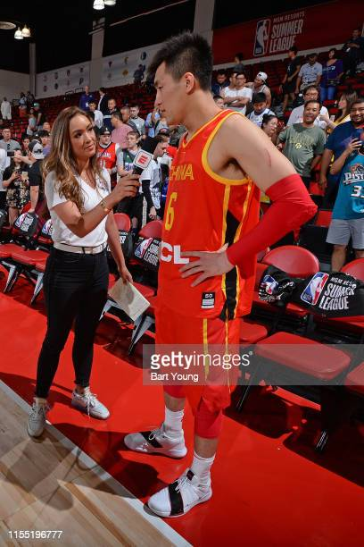 Cassidy Hubbarth speaks to Ailun Guo of China after the game against the Charlotte Hornets on July 8 2019 at the Cox Pavilion in Las Vegas Nevada...
