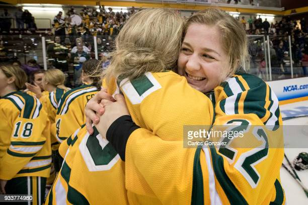 Cassidy Vinkle of Clarkson University celebrated with teammates after winning the Division I Women's Ice Hockey Championship held at Ridder Arena on...