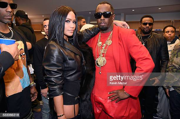 Cassie and Sean Diddy Combs aka Puff Daddy pose backstage during the Puff Daddy and The Family Bad Boy Reunion Tour presented by Ciroc Vodka and Live...