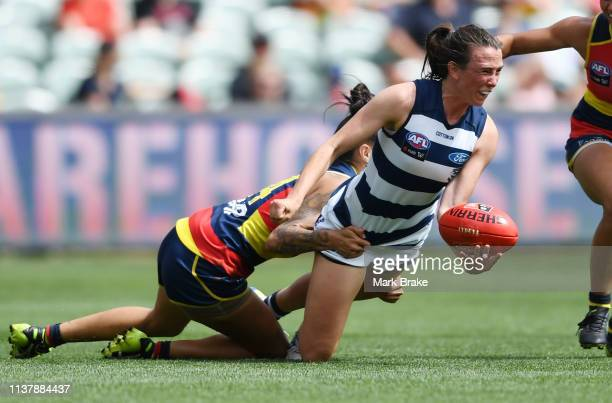 Cassie Blakeway of the Cats handballs tackle by StevieLee Thompson of the Adelaide Crows during the AFLW Preliminary Final match between the Adelaide...