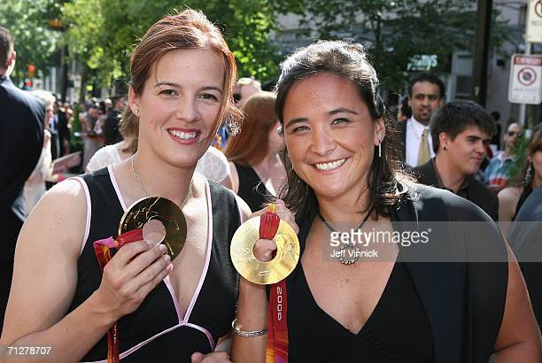 Cassie Campbell and Vicky Sunohara of the Canadian women's ice hockey team pose with their 2006 Olympic gold medals as they arrive to the the NHL TV...