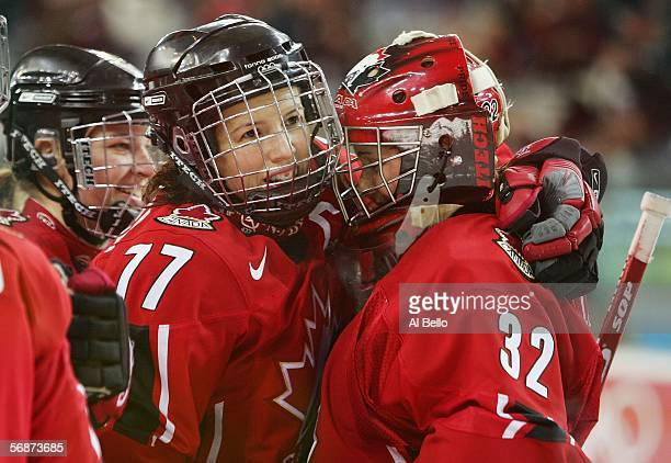 Cassie Campbell of Canada congratulates goalie Charline Labonte after defeating Finland 60 in the women's ice hockey semifinals on Day 7 of the Turin...