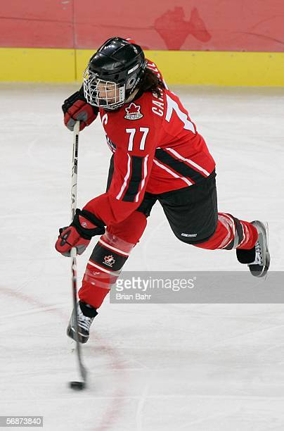 Cassie Campbell of Canada hits a slap shot during the women's ice hockey semifinals game against Finland on Day 7 of the Turin 2006 Winter Olympic...
