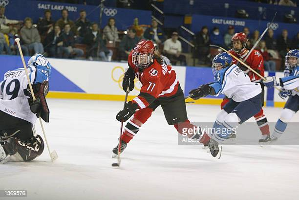 Cassie Campbell of Canada shoots the last goal against Tuula Puputti of Finland during the Salt Lake City Winter Olympic Games on February 17 2002 at...
