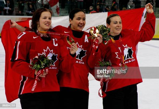 Cassie Campbell Vicky Sunohara and Jayna Hefford all of Canada celebrate winning the gold medal in women's ice hockey with a 41 victory over Sweden...