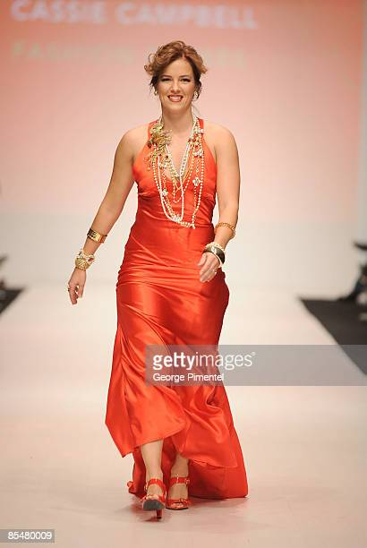 Cassie Campbell walks the runway wearing a Fashion Crimes design for the The Heart Truth Fashion Show at LG Fashion Week at Nathan Phillips Square on...
