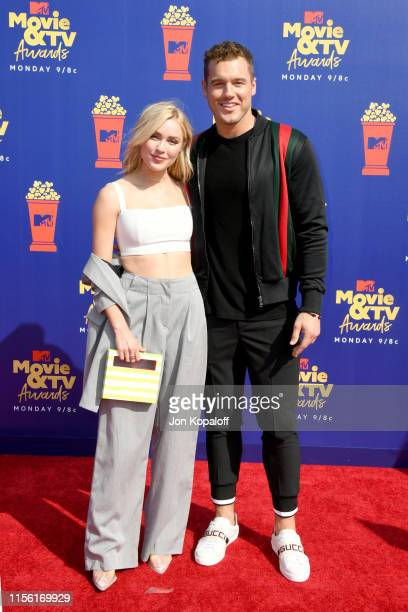 Cassie Randolph and Colton Underwood attends the 2019 MTV Movie and TV Awards at Barker Hangar on June 15 2019 in Santa Monica California
