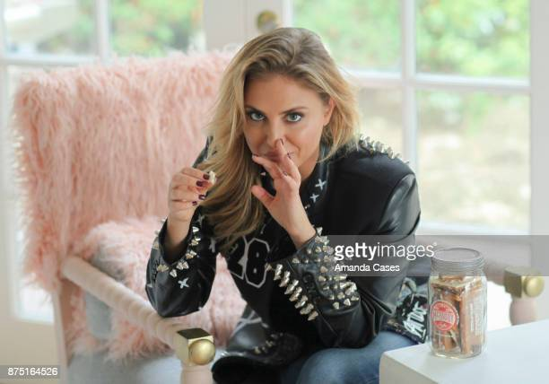 Cassie Scerbo eating McFaddy Toffee in a Vampire Rockstar jacket at A Day of Inspiration at TAP The Artists Project on November 15 2017 in Los...