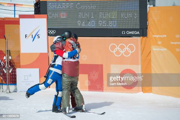 Cassie Sharpe Canada takes gold and celebrates with Marie Martinod France SILVER and Brita Sigourney USA BRONZE following the women's skiing halfpipe...