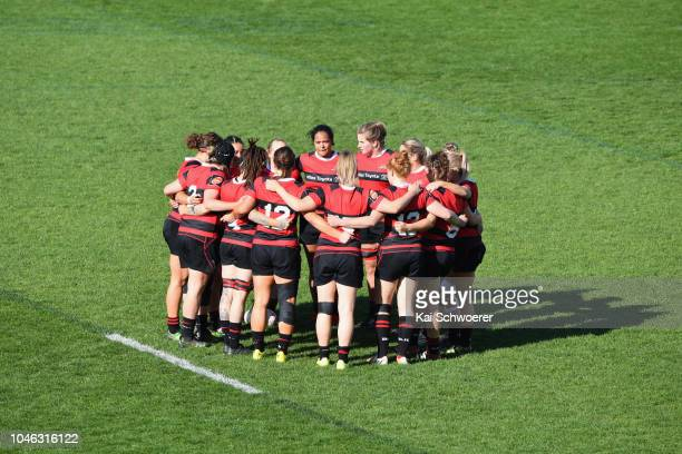 Cassie Siataga of Canterbury and her team mates huddle prior to the round six Farah Palmer Cup match between Canterbury and Auckland at Christchurch...