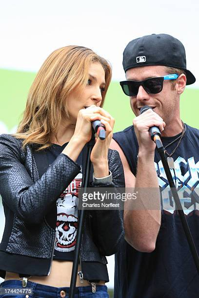 Cassie Silva and Cody Scott Lancaster of the Broadway show Rock of Ages perform durng 1067 LITE FM's Broadway in Bryant Park 2013 at Bryant Park on...