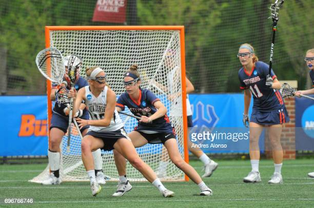 Cassie Smith of Gettysburg College defends Kathleen Jaeger of the College of New Jersey during the Division III Women's Lacrosse Championship held at...