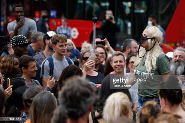 Cassie Sunshine' wears a g-string on her face as she speaks during the Keep Britain Free movement anti-mask protest on July 19, 2020 in London,...