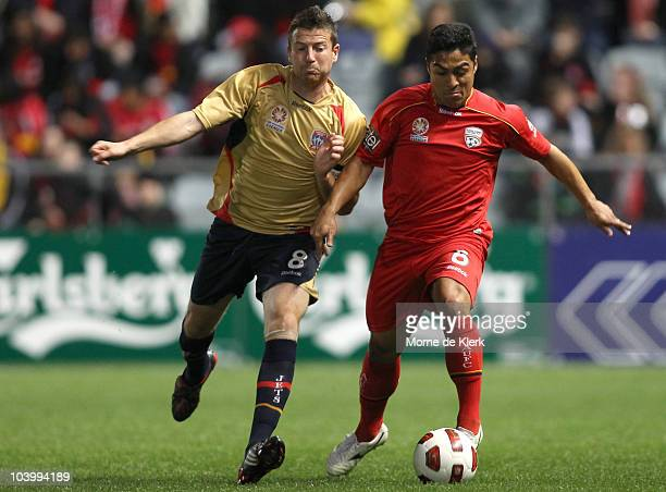 Cassio of Adelaide and Michael Bridges of the Jets compete for the ball during the round six ALeague match between Adelaide United and the Newcastle...