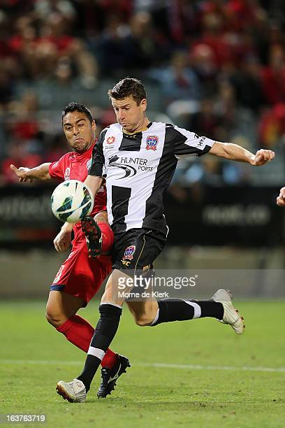 Cassio of Adelaide competes with Michael Bridges of the Jets during the round 25 ALeague match between Adelaide United and the Newcastle Jets at...