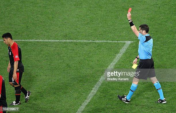 Cassio of Adelaide is given a red card and sent from the field by referee Ben Williams during the round seven ALeague match between the Brisbane Roar...