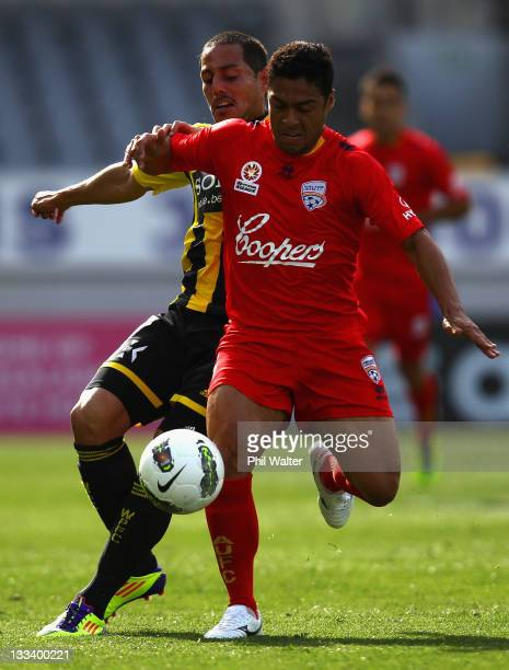 Cassio of Adelaide United is tackled by Lee Bertos of the Wellington Phoenix during the round seven A-League match between the Wellington Phoenix and...